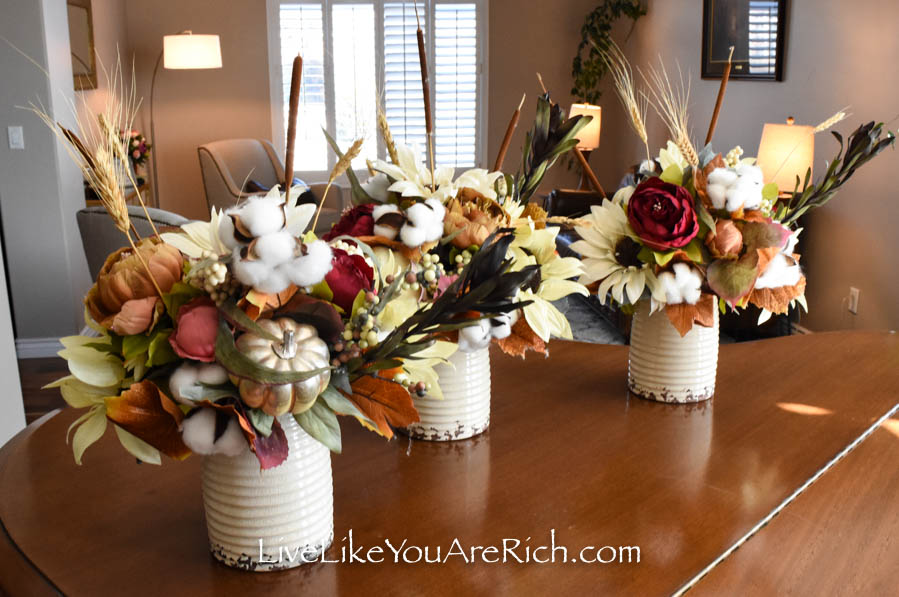 These artificial Fall flower arrangements are great for home decor.
