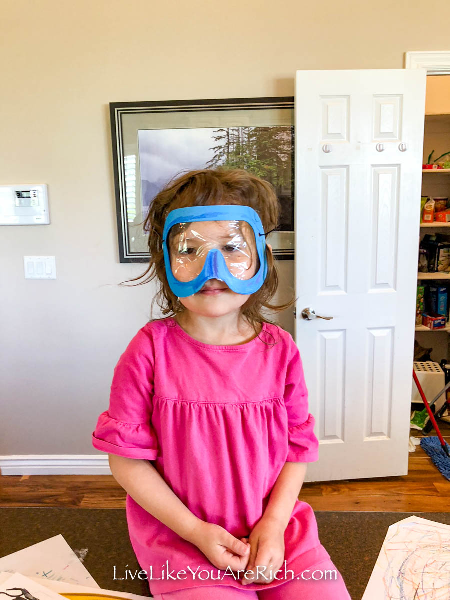 Aurora wearing her scuba diving mask.