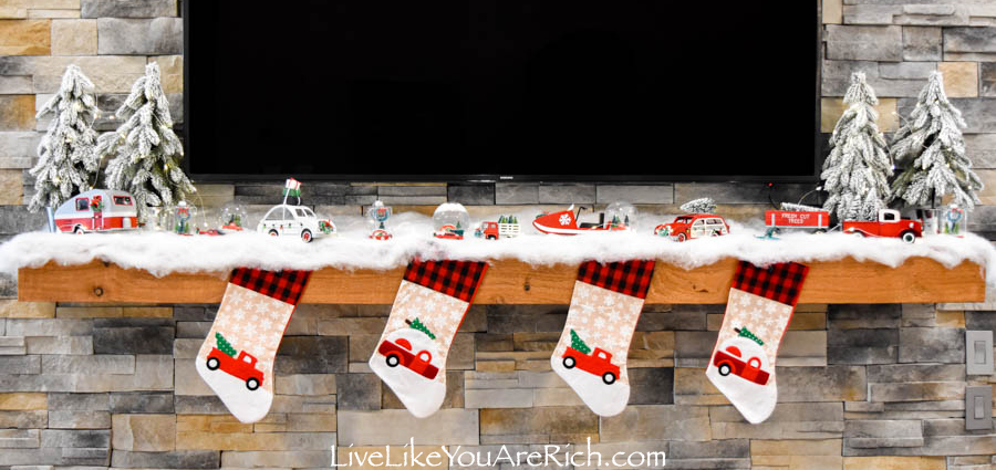 Red Truck Christmas decorations under fireplace