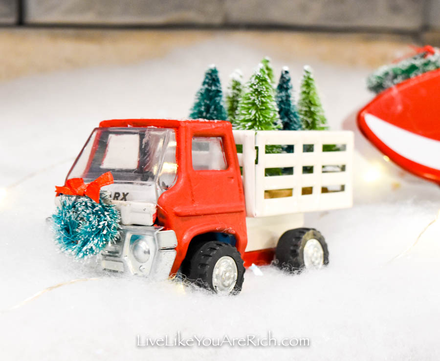 Restored red truck with mini Christmas trees