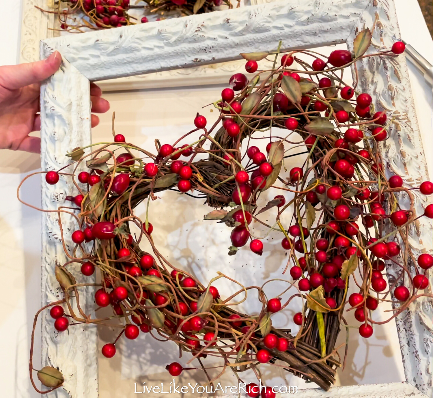 Berry Heart Wreath in a Vintage Frame on display