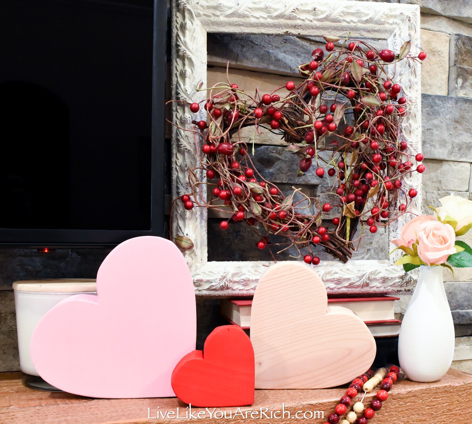 Painted wood heart shape and framed wreath