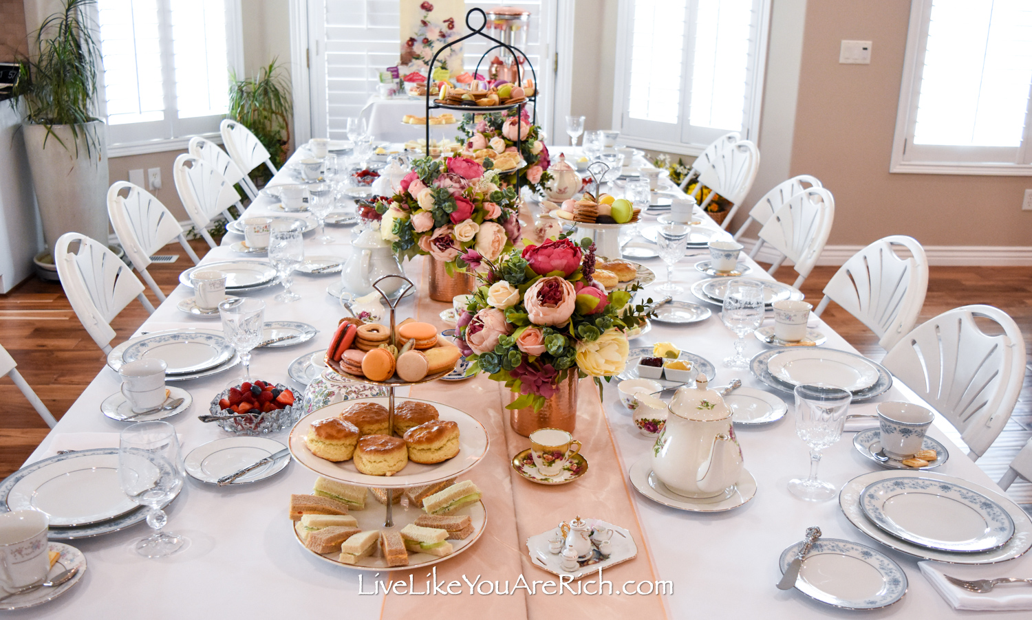 Peony and rose flower arrangement used for tea party event