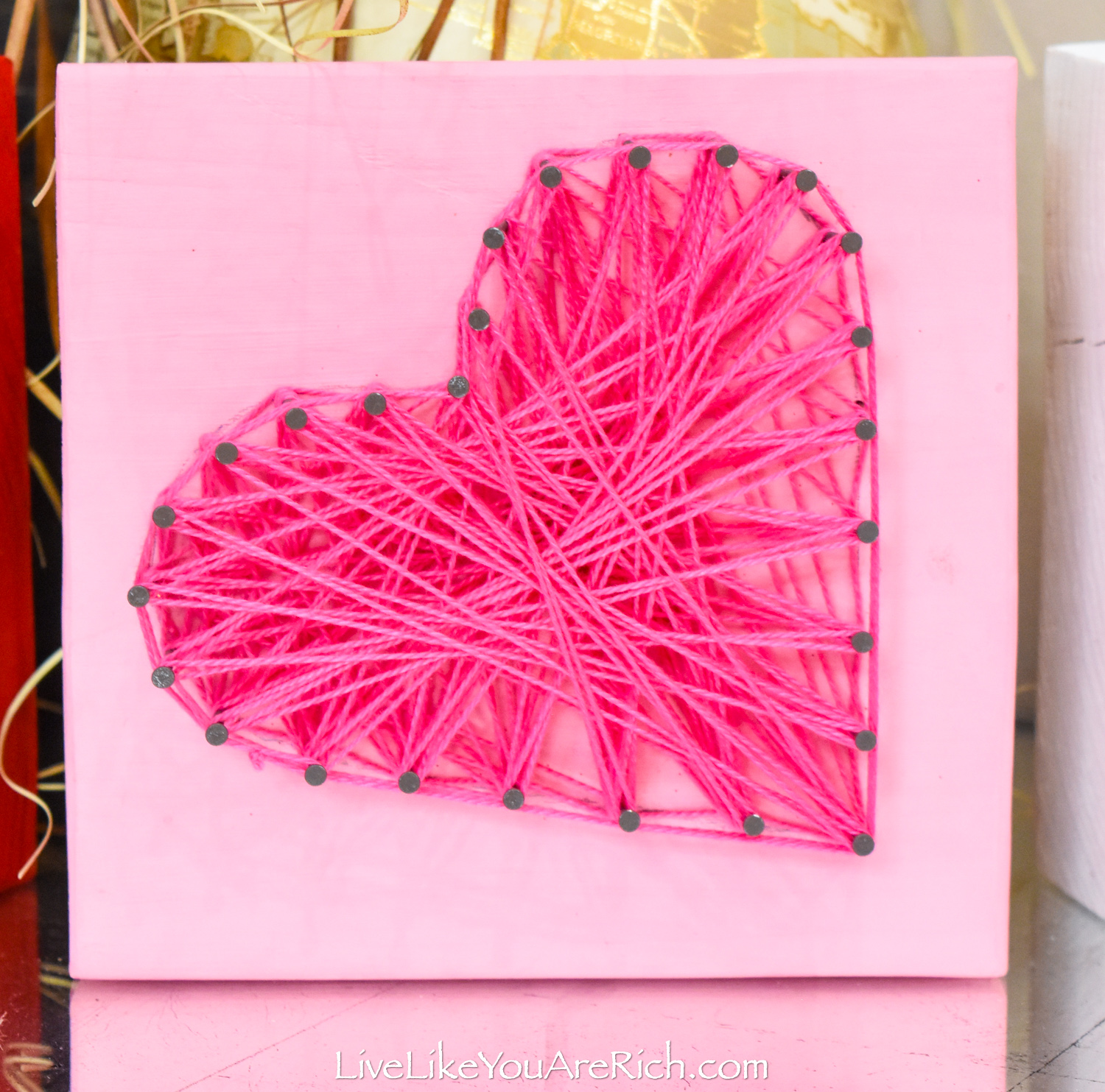 Valentine's String Heart Craft in pink block wood