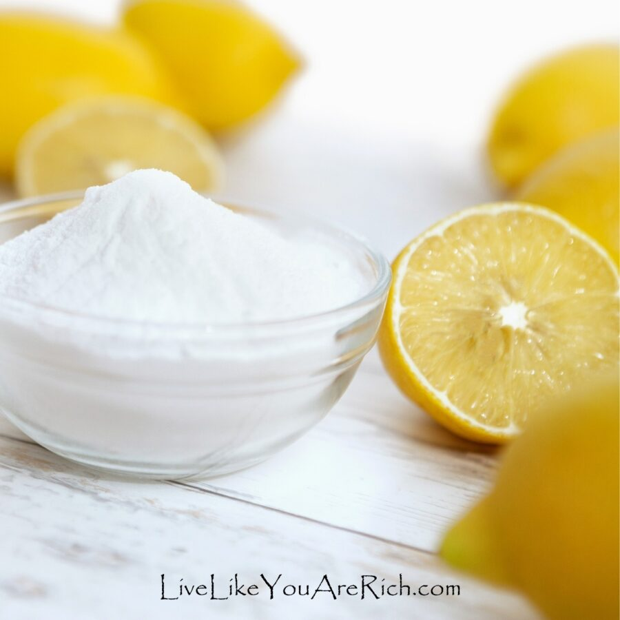 cleaning food container with baking soda and lemon juice