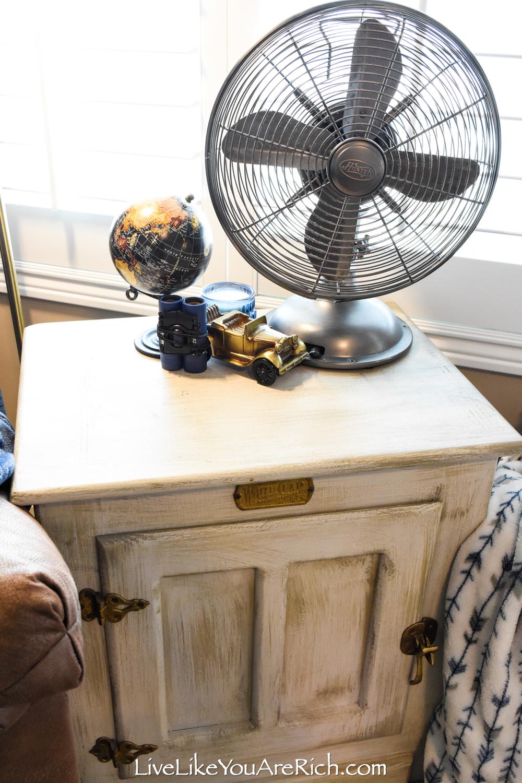 Travel Themed Boy Nursery side table with vintage fan